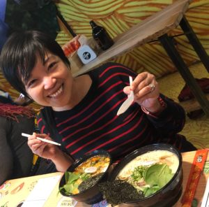 Hazel Malapit, Senior Research Coordinator at the Poverty, Health and Nutrition Division at the International Food Policy Research Institute (IFPRI), enjoying a dish of soupy noodles. Photo courtesy of Hazel Malapit.